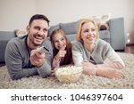 father mather and daughter... | Shutterstock . vector #1046397604