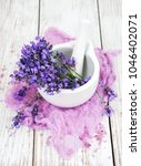 bath salt and fresh lavender on ... | Shutterstock . vector #1046402071