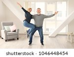 happy mature couple dancing at... | Shutterstock . vector #1046448454
