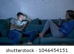 young couple at home sofa couch ... | Shutterstock . vector #1046454151