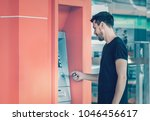 young man using credit card for ... | Shutterstock . vector #1046456617
