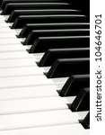 Diagonal close up of Piano Keyboard plenty of white and black space - stock photo