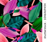 seamless tropical leaves and... | Shutterstock . vector #1046469454