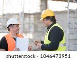 two happy civil engineers... | Shutterstock . vector #1046473951