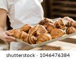 cropped shot of female baker... | Shutterstock . vector #1046476384