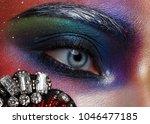beautiful girl with creative... | Shutterstock . vector #1046477185