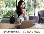 young happy woman holding a... | Shutterstock . vector #1046477527