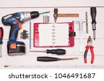 construction tooling on wooden... | Shutterstock . vector #1046491687