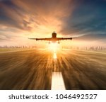 air plane flying over airport... | Shutterstock . vector #1046492527