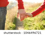 the parent holds the hand of a...   Shutterstock . vector #1046496721