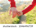 the parent holds the hand of a...   Shutterstock . vector #1046496739