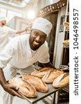 happy african american baker... | Shutterstock . vector #1046498557