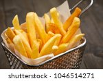 french fries in the basket | Shutterstock . vector #1046514271