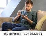 diabetic man taking blood... | Shutterstock . vector #1046522971