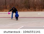 dad teaching his 2 years son to ...   Shutterstock . vector #1046551141
