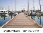 white yachts in the port are... | Shutterstock . vector #1046579245