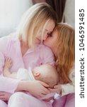 mom blonde with older daughter...   Shutterstock . vector #1046591485