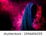 dark silhouette in colorful... | Shutterstock . vector #1046606335