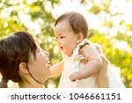 young mother lift and playing...   Shutterstock . vector #1046661151
