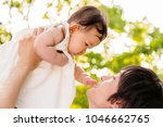 young father lift and playing...   Shutterstock . vector #1046662765