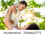 young father lift and playing...   Shutterstock . vector #1046662771