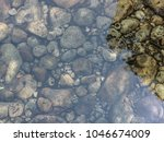 stones and a rounded pebble ... | Shutterstock . vector #1046674009