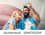 modern young couple eating and... | Shutterstock . vector #1046702209