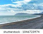 a long stony beach   killiney ... | Shutterstock . vector #1046723974