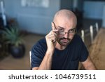 a stylish man with eyeweat is... | Shutterstock . vector #1046739511