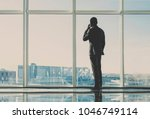 back view of young businessman... | Shutterstock . vector #1046749114