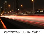 the red light of the car at the ... | Shutterstock . vector #1046759344