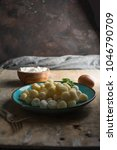 Small photo of Raw gnocchi, typical Italian made of potato, flour and egg dish. Perfect meal to accompany with a sauce.