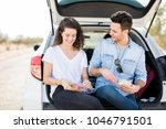 happy young couple sitting... | Shutterstock . vector #1046791501