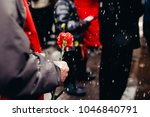 adult holds red carnation.... | Shutterstock . vector #1046840791