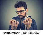 young serious man with... | Shutterstock . vector #1046862967