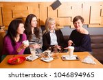informal meeting friends in cafe   Shutterstock . vector #1046894965