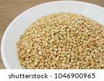 green buckwheat on the white... | Shutterstock . vector #1046900965