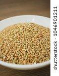 green buckwheat in white plate  ... | Shutterstock . vector #1046901211