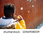 little boy with yellow coat... | Shutterstock . vector #1046908039