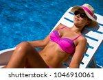 the beautiful woman in bikini... | Shutterstock . vector #1046910061