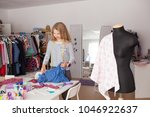 portrait of female dressmaker...   Shutterstock . vector #1046922637