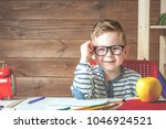 happy smiling boy in glasses at ... | Shutterstock . vector #1046924521