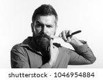 bearded man having shave in...   Shutterstock . vector #1046954884