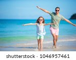 happy father and his adorable...   Shutterstock . vector #1046957461