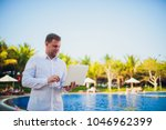 working on laptop from the...   Shutterstock . vector #1046962399
