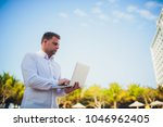 working on laptop from the...   Shutterstock . vector #1046962405