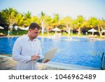 working on laptop from the...   Shutterstock . vector #1046962489