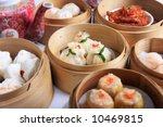a variety of dim sum in bamboo... | Shutterstock . vector #10469815