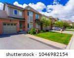 custom built luxury house in... | Shutterstock . vector #1046982154
