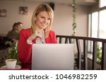 business woman is working on...   Shutterstock . vector #1046982259